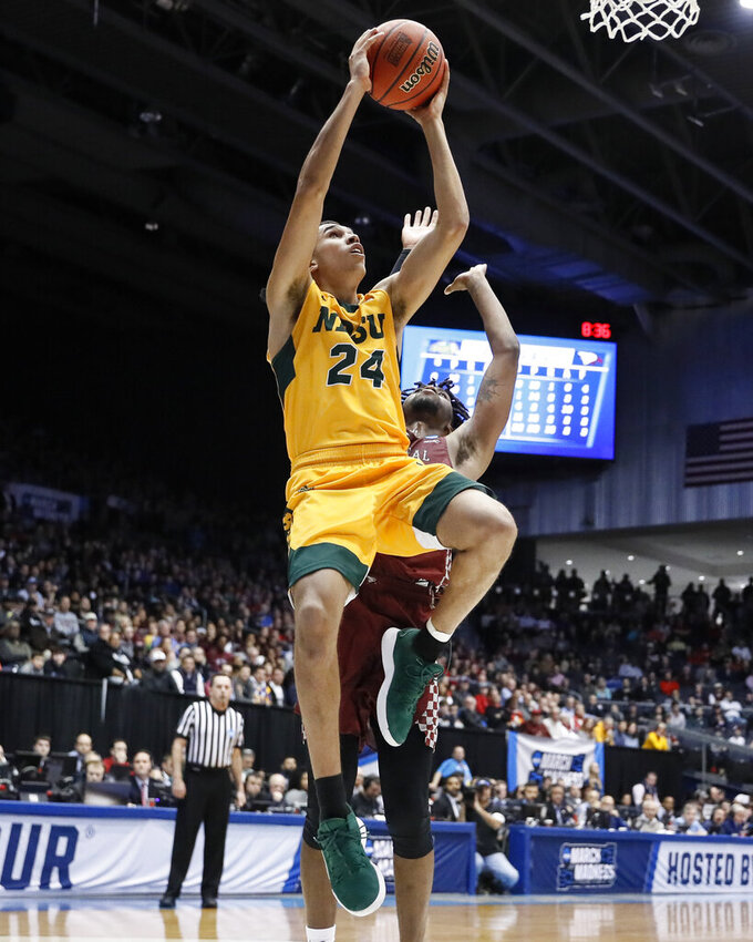 North Dakota State's Tyson Ward (24) shoots over North Carolina Central's Zacarry Douglas during the second half of a First Four game of the NCAA men's college basketball tournament Wednesday, March 20, 2019, in Dayton, Ohio. (AP Photo/John Minchillo)
