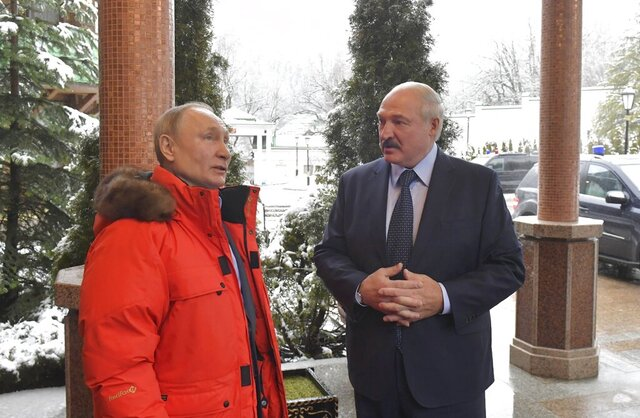 Russian President Vladimir Putin, left, and Belarusian President Alexander Lukashenko talk during their meeting in the Black sea resort of Sochi, Russia, Friday, Feb. 7, 2020. Russian President Vladimir Putin is hosting the leader of Belarus for another round of talks on closer integration amid mounting Russian economic pressure on its ex-Soviet ally. (Andrei Stasevich/BelTA Pool Photo via AP)