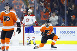 Philadelphia Flyers' Joel Farabee, right, celebrates past Philippe Myers, left, and Montreal Canadiens' Ben Chiarot after scoring a goal during the first period of an NHL hockey game, Thursday, Jan. 16, 2020, in Philadelphia. (AP Photo/Matt Slocum)