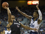 San Diego State forward Matt Mitchell (11) is fouled by Nevada forward Jordan Brown (21) in the first half of an NCAA college basketball game in Reno, Nev., Saturday, March 9, 2019. (AP Photo/Tom R. Smedes)