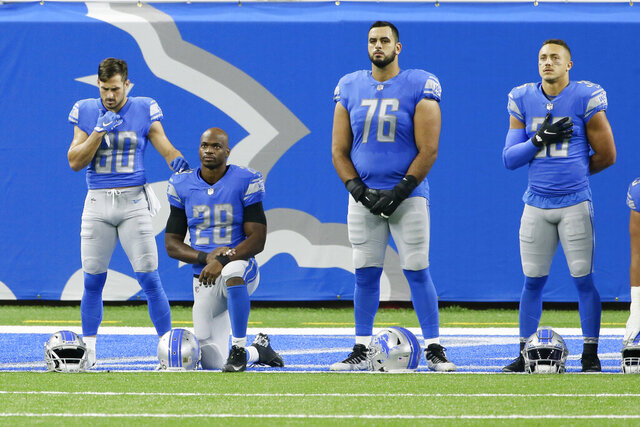 Detroit Lions offensive guard Oday Aboushi (76), stands with wide receiver Danny Amendola (80), running back Adrian Peterson (28) and safety Miles Killebrew (35) during the national anthem before an NFL football game, Sunday, Nov. 15, 2020, in Detroit. NFL players have kneeled during the anthem and have made stands to protest social injustice, but none have done it in quite the same way as Aboushi. He wants to use his platform to shed light on what he says is Israel's oppression of the Palestinians and to promote religious harmony as a Muslim with friends of different faiths. (AP Photo/Duane Burleson)