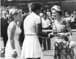 FILE - In this July 6, 1957 file photo, Queen Elizabeth II, right, presents winners trophy to Althea Gibson who won the women's title in the All England Lawn Tennis Championship at Wimbledon. When the US Open begins this week, she will have a statue unveiled in her honor. Says tennis great Billie Jean King: