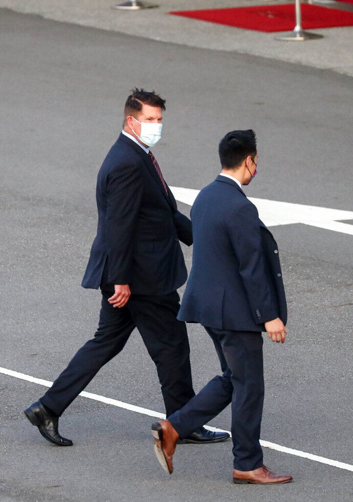 U.S. Under Secretary of State Keith Krach, left, walks away after disembarking from a plane upon arrival at the air force base airport in Taipei, Taiwan Thursday, Sept. 17, 2020. Krach is in Taiwan on Thursday for the second visit by a high-level American official in two months, prompting a stern warning and threat of possible retaliation from China. (Pool Photo via AP Photo)