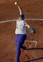 Washington starting pitcher Taran Alvelo (14) pitches in the first inning of the second softball game of the best-of-three championship series in the NCAA Women's College World Series in Oklahoma City, Tuesday, June 5, 2018. Alvelo is an American with Puerto Rican ties who will help the unincorporated U.S. territory try to qualify for the 2020 Olympics in Tokyo. (AP Photo/Sue Ogrocki, File)