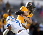 Appalachian State quarterback Zac Thomas is sacked by Georgia State's Jordan Strachan in the first half of an NCAA football game, Saturday, Nov. 14, 2020, in Boone, N.C. (Walt Unks/Winston-Salem Journal via AP)