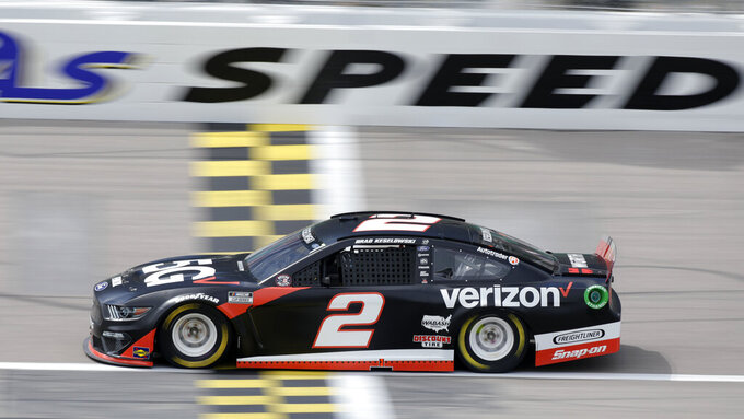 Brad Keselowski crosses the start/finish line as he heads down a straightaway during a NASCAR Cup Series auto race at Kansas Speedway in Kansas City, Kan., Sunday, May 2, 2021. (AP Photo/Colin E. Braley)