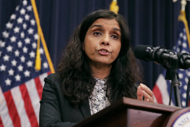 Commissioner of the Massachusetts Department of Public Health, Dr. Monica Bharel addresses reporters on coronavirus preparedness and planning at the Statehouse in Boston, Tuesday, March 10, 2020. For most people, the new coronavirus causes only mild or moderate symptoms, such as fever and cough. For some, especially older adults and people with existing health problems, it can cause more severe illness, including pneumonia. (AP Photo/Charles Krupa)
