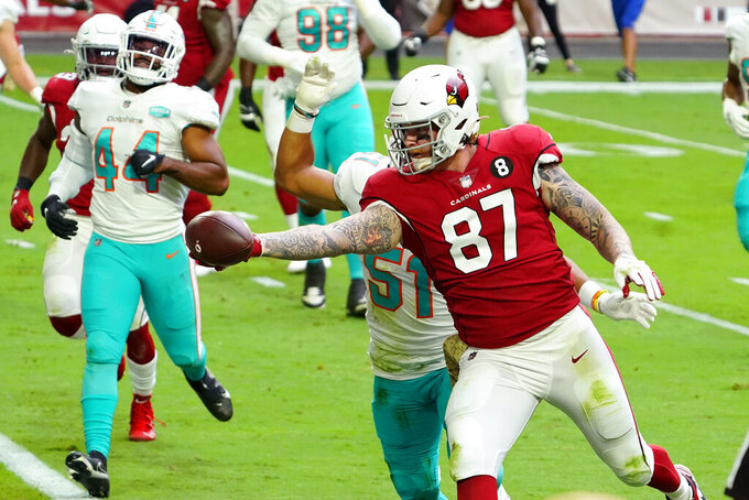 Arizona Cardinals tight end Maxx Williams (87) scores a touchdown as Miami Dolphins outside linebacker Kamu Grugier-Hill (51) defends during the first half of an NFL football game, Sunday, Nov. 8, 2020, in Glendale, Ariz. (AP Photo/Rick Scuteri)
