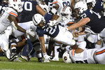 Penn State running back Noah Cain (21) dives for extra yardage near the goal line while being tackled by Auburn defensive tackle Marquis Burks (92) during the first half of an NCAA college football game in State College, Pa., on Saturday, Sept. 18, 2021. (AP Photo/Barry Reeger)