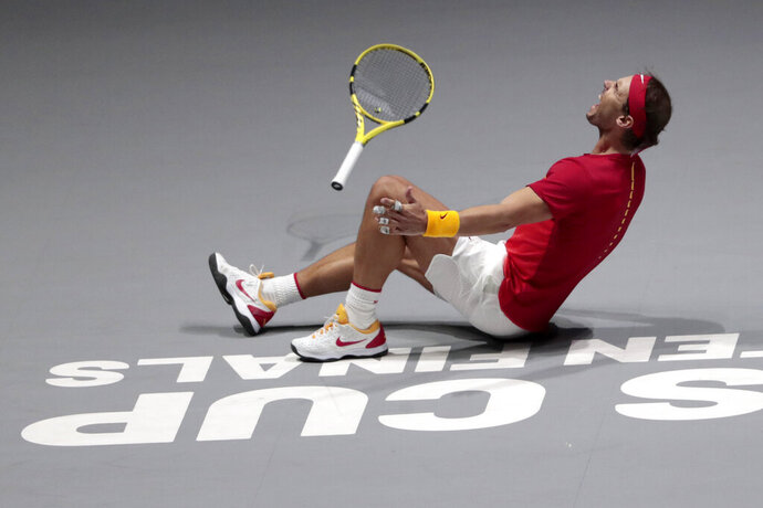 Spain's Rafael Nadal reacts after defeating Canada's Denis Shapovalov in their tennis singles match to win the Davis Cup final in Madrid, Spain, Sunday, Nov. 24, 2019. (AP Photo/Bernat Armangue)