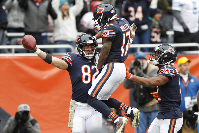 Chicago Bears tight end Ben Braunecker (82) celebrates his 18-yard touchdown reception with Anthony Miller (17) against the Detroit Lions during the first half of an NFL football game in Chicago, Sunday, Nov. 10, 2019. (AP Photo/Charlie Neibergall)