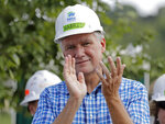 FILE - In this Sept. 26, 2018 file photo Republican congressional candidate Mark Harris applauds during a Habitat For Humanity building event in Charlotte, N.C. Harris, the Republican in the nation's last undecided congressional election, said Monday, Feb. 11, 2019 he recruited a political operative now at the center of a ballot fraud investigation because he produced election results in his rural North Carolina county and other Republicans vouched for him. (AP Photo/Chuck Burton, file)
