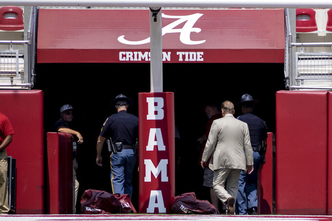 Alabama head coach Nick Saban, right, exits the field after walking it before an NCAA college football game against Mercer, Saturday, Sept. 11, 2021, in Tuscaloosa, Ala. (AP Photo/Vasha Hunt)