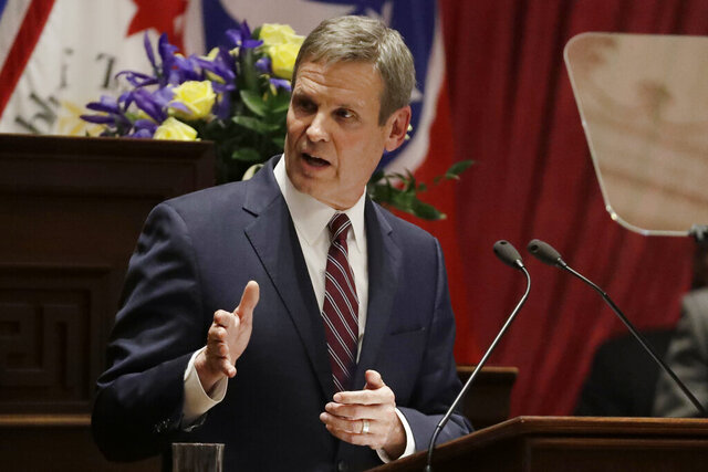 FILE - In this Feb. 3, 2020 file photo, Tennessee Gov. Bill Lee delivers his State of the State Address in the House Chamber in Nashville, Tenn.  Bill Lee declared a state of emergency Thursday, March 12, to help the state address the spread of the new coronavirus. The emergency declaration frees up additional funds and relaxes rules surrounding assistance from state agencies to affected communities. (AP Photo/Mark Humphrey, File)