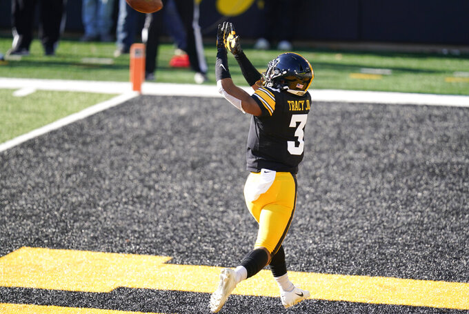 Iowa wide receiver Tyrone Tracy Jr. catches a 6-yard touchdown pass during the first half of an NCAA college football game against Nebraska, Friday, Nov. 27, 2020, in Iowa City, Iowa. (AP Photo/Charlie Neibergall)