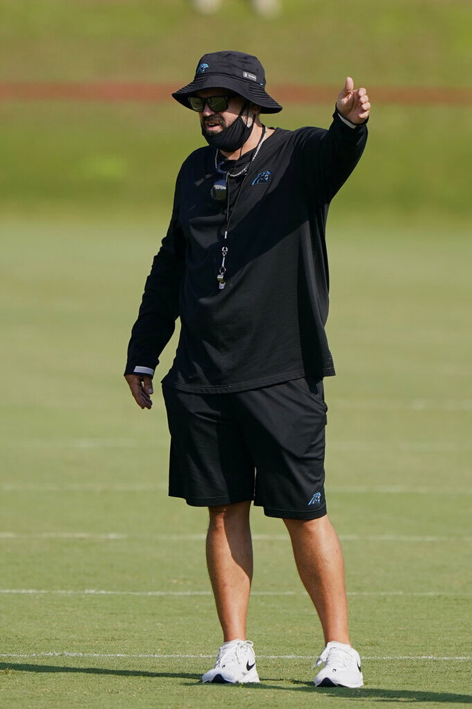 Carolina Panthers head coach Matt Rhule gestures during an NFL football camp practice Monday, Aug. 17, 2020, in Charlotte, N.C. (AP Photo/Chris Carlson)