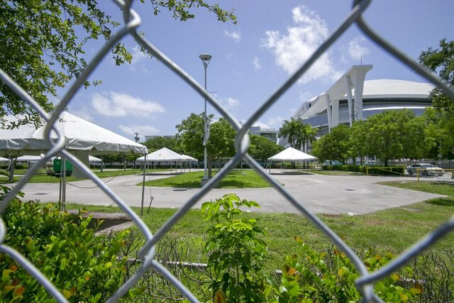 The Covid-19 test center at Marlins Park is closed due Hurricane Isaias on Friday, July 31, 2020, in Miami. Hurricane Isaias' imminent arrival has forced the closure of some outdoor coronavirus testing sites in Florida, even as the state continues to tally record daily deaths. (Al Diaz /Miami Herald via AP)