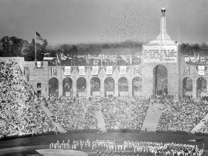 Doves are released during the opening ceremony for the Tenth Olympiad in Los Angeles on July 30, 1932. The athletes of various countries stand on the field. (AP Photo)
