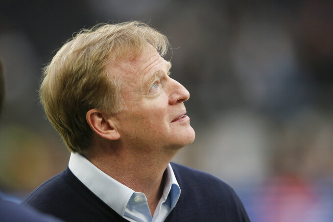 CORRECTS STADIUM TO TOTTENHAM HOTSPUR STADIUM INSTEAD OF WEMBLEY STADIUM - NFL Commissioner Roger Goodell looks at Tottenham Hotspur Stadium before an NFL football game between the Chicago Bears and the Oakland Raiders, Sunday, Oct. 6, 2019, in London. (AP Photo/Tim Ireland)