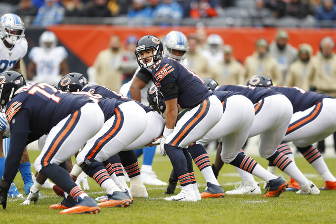FILE - In this Nov. 10, 2019, file photo, Chicago Bears quarterback Mitchell Trubisky calls out at the line of scrimmage during the first half of the team's NFL football game against the Detroit Lions in Chicago. With the draft approaching, the Bears need better blocking to protect the quarterback and create holes for the running backs. (AP Photo/Charlie Neibergall, File)