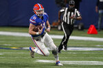 Florida quarterback Kyle Trask (11) runs out of the pocket against Alabama during the first half of the Southeastern Conference championship NCAA college football game, Saturday, Dec. 19, 2020, in Atlanta. (AP Photo/John Bazemore)