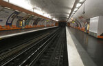 An empty metro line platform is pictured empty Friday Sept.13, 2019 in Paris. A massive strike is paralyzing Paris public transports on Friday as unions protest a sweeping pension reform by French President Emmanuel Macron's government. Paris public transport company RATP says 10 metro lines are closed and several others, including the RER suburban rail, are severely disrupted. (AP Photo/Bertrand Combaldieu)