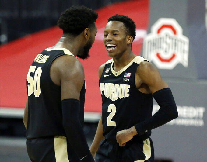 Purdue guard Eric Hunter, right, and teammate forward Trevion Williams celebrate an NCAA college basketball game win over Ohio State in Columbus, Ohio, Tuesday, Jan. 19, 2021. (AP Photo/Paul Vernon)
