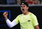 Canada's Milos Raonic celebrates after defeating Greece's Stefanos Tsitsipas in their third round singles match at the Australian Open tennis championship in Melbourne, Australia, Friday, Jan. 24, 2020. (AP Photo/Andy Wong)