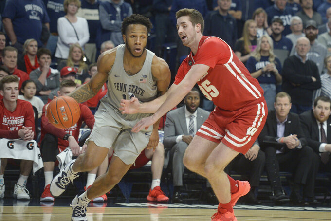 Penn State's Lamar Stevens (11) drives the baseline on Wisconsin's Nate Reuvers (35) in first half action in an NCAA college basketball game, Saturday, Jan. 11, 2020, in State College, Pa. (AP Photo/Gary M. Baranec)