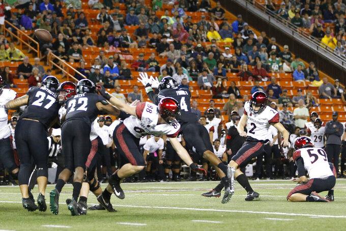 San Diego State's Matt Araiza (2) kicks a field goal during the first half of the team's NCAA college football game against Hawaii on Saturday, Nov. 23, 2019, in Honolulu. (AP Photo/Marco Garcia)