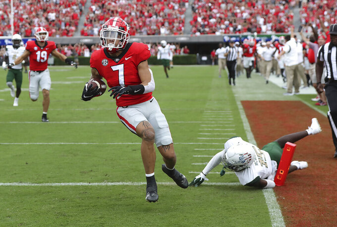 Georgia wide receiver Jermaine Burton catches a pass from Stetson Bennett for a touchdown on the opening drive against UAB during the first quarter of an NCAA college football game on Saturday, Sept. 11, 2021, in Athens, Ga. (Curtis Compton/Atlanta Journal-Constitution via AP)