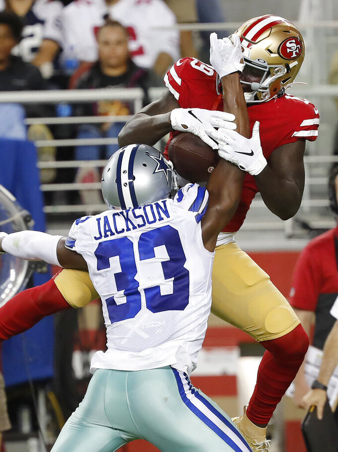 San Francisco 49ers wide receiver Deebo Samuel, top, catches a pass over Dallas Cowboys cornerback Michael Jackson during the second half of an NFL preseason football game in Santa Clara, Calif., Saturday, Aug. 10, 2019. (AP Photo/Josie Lepe)