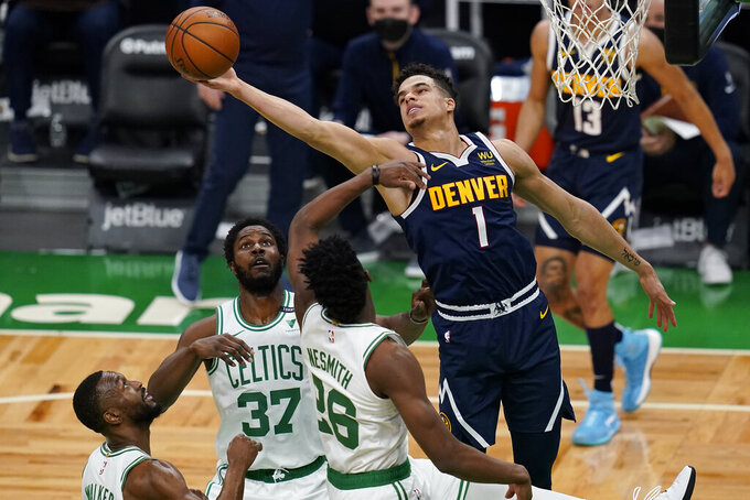 Denver Nuggets forward Michael Porter Jr. (1) grabs a rebound over the Boston Celtics during the first half of an NBA basketball game, Tuesday, Feb. 16, 2021, in Boston. (AP Photo/Charles Krupa)