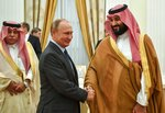 FILE - In this Thursday, June 14, 2018 file photo, President Vladimir Putin, shakes hands with Saudi Arabian Crown Prince Mohammed bin Salman, right, during their meeting in Moscow, Russia. (Yuri Kadobnov/Pool via AP)