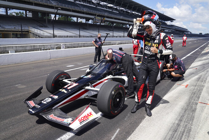 Rinus VeeKay, of the Netherlands, takes off his helmet during qualifications for the Indianapolis 500 auto race at Indianapolis Motor Speedway, Sunday, Aug. 16, 2020, in Indianapolis. (AP Photo/Darron Cummings)
