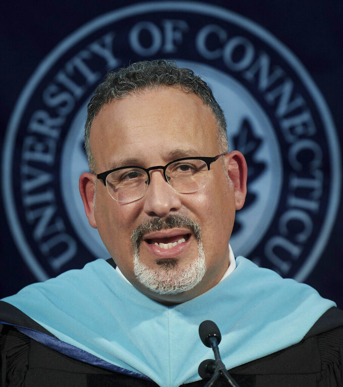 This photo shows U.S. Secretary of Education Miguel Cardona as he delivers remarks, during a video recording address for University of Connecticut graduating students at Pratt & Whitney Stadium in East Hartford, Conn., Friday May 7, 2021. (Peter Morenus/UConn Photo via AP)