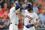 Houston Astros' Jake Meyers (6) celebrates with Carlos Correa after hitting a three-run home run against the Seattle Mariners during the second inning of a baseball game Monday, Sept. 6, 2021, in Houston. (AP Photo/David J. Phillip)