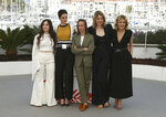 Actresses Luana Bajrami, from left, Noemie Merlant, director Celine Sciamma, actresses Adele Haenel and Valeria Golino pose for photographers at the photo call for the film 'Portrait of a Lady on Fire' at the 72nd international film festival, Cannes, southern France, Monday, May 20, 2019. (Photo by Joel C Ryan/Invision/AP)