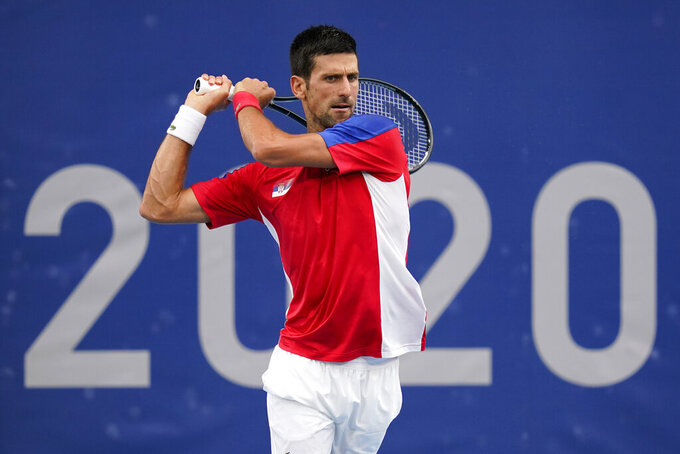 Novak Djokovic, of Serbia, returns to Alexander Zverev, of Germany, during the semifinal round of the men's tennis competition at the 2020 Summer Olympics, Friday, July 30, 2021, in Tokyo, Japan. (AP Photo/Patrick Semansky)