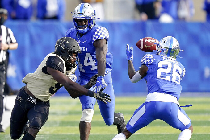 Kentucky defensive back Brandin Echols (26) breaks up a pass intended for Vanderbilt running back Rocko Griffin (9) during the second half of an NCAA college football game, Saturday, Nov. 14, 2020, in Lexington, Ky. (AP Photo/Bryan Woolston)