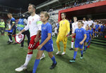 Denmark's captain Christian Offenberg leads his team to the pitch prior a friendly soccer match between Slovakia and Denmark in Trnava, Slovakia, Wednesday, Sept. 5, 2018. Every player in Denmark's squad are uncapped following a dispute between Denmark's star players and the Danish Football Association. (AP Photo/Ronald Zak)