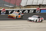 Noah Gragson (9) and Harrison Burton (20) come out of turn four onto the front stretch during a NASCAR Xfinity Series auto race at Texas Motor Speedway in Fort Worth, Texas, Saturday Oct. 24, 2020. (AP Photo/Richard W. Rodriguez)