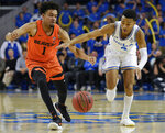 UCLA guard Jaylen Hands, right, attempts to dribble past Oregon State guard Stephen Thompson Jr. during the second half of an NCAA college basketball game in Los Angeles, Thursday, Feb. 21, 2019. UCLA won 68-67. (AP Photo/Kelvin Kuo)