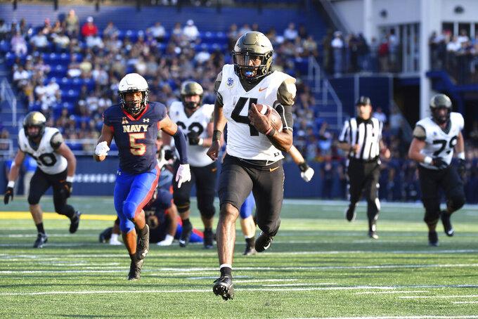 Air Force quarterback Haaziq Daniels (4) runs the ball for a second half touchdown during an NCAA college football game against Navy, Saturday, Sept. 11, 2021, in Annapolis, Md. (AP Photo/Terrance Williams)