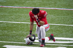 Ohio State quarterback Justin Fields pauses before the start of the Big Ten championship NCAA college football game against Northwestern, Saturday, Dec. 19, 2020, in Indianapolis. (AP Photo/Darron Cummings)