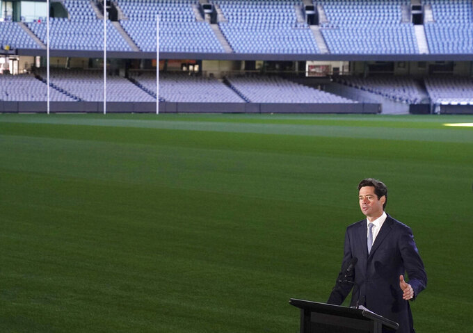 Australian Football League CEO Gillon McLachlan speaks to the media during a press conference in Melbourne, Friday, May 15, 2020. Aussie rules soccer will kick off again on June 11, with the second round of the Australian Football League to be played almost three months after the competition was suspended because of the coronavirus pandemic. (Michael Dodge/AAP Image via AP)