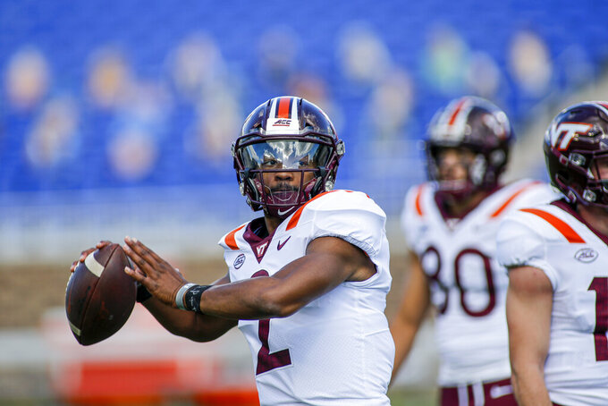 Virginia Tech quarterback Hendon Hooker (2) warms up before playing against Duke in an NCAA college football game, Saturday, Oct. 3, 2020, in Durham, N.C.  (Nell Redmond/Pool Photo via AP)