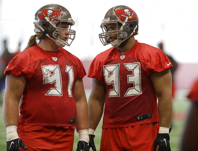 Tampa Bay Buccaneers nose tackle Ndamukong Suh (93) talks to defensive tackle Beau Allen (91) talk during an NFL football minicamp Tuesday, June 4, 2019, in Tampa, Fla. (AP Photo/Chris O'Meara)