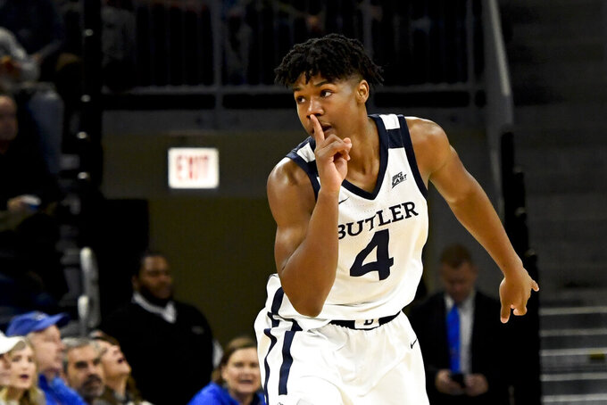 Butler guard Khalif Battle (4) after sinking a 3-point basket against DePaul during the first half of an NCAA college basketball game Saturday, Jan. 18, 2020, in Chicago. (AP Photo/Matt Marton)