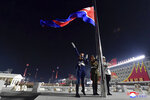 In this photo provided by the North Korean government a North Korean flag is hoisted in the celebration for the ruling party congress, at Kim Il Sung Square in Pyongyang, North Korea Thursday, Jan. 14, 2021. Independent journalists were not given access to cover the event depicted in this image distributed by the North Korean government. The content of this image is as provided and cannot be independently verified. Korean language watermark on image as provided by source reads: